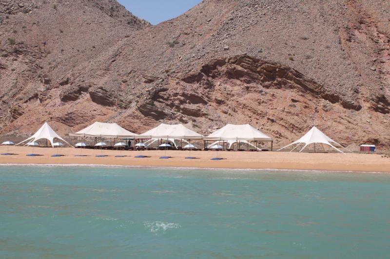 ... centre and the Shangri-la resort from the sea. In a while you?ll